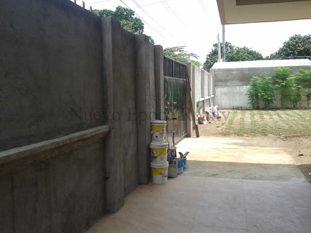 the steel-gated and concrete fence